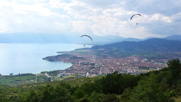 Paragliders flying above city Ohrid, North Macedonia
